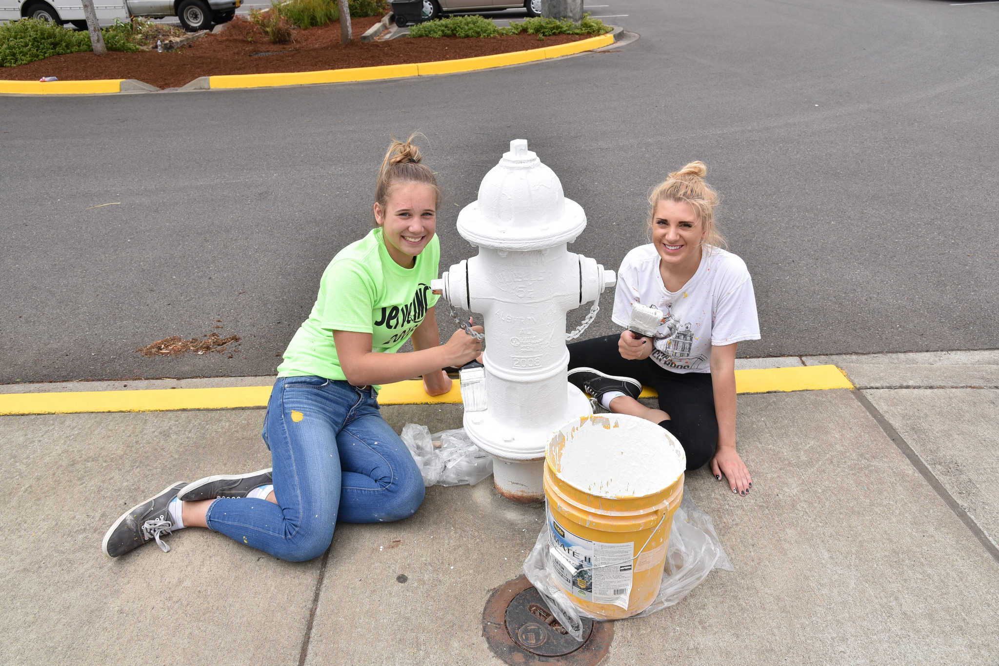 Volunteers also painted curbs and hydrants at Timber Ridge School.